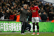 Manchester United Manager Jose Mourinho (L) reacts and shows his fury with Paul Pogba of Manchester United (R) after his team concede a second goal. Premier league match, Tottenham Hotspur v Manchester Utd at Wembley Stadium in London on Wednesday 31st January 2018.<br /> pic by Steffan Bowen, Andrew Orchard sports photography.