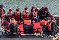 © Licensed to London News Pictures. 16/10/2021. DOVER, UK. Migrants arriving at Dover docks again today whilst weather conditions are still good, the sea is calm and before the weather changes for winter. Photo credit: Stuart Brock/LNP