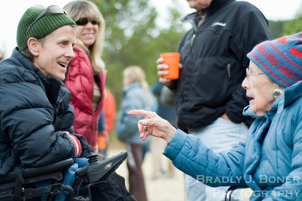 NEWS&GUIDE PHOTO / BRADLY J. BONER.Jimmy Zell visits with Betty Raymer, mother of the late Tom Raymer, during Goatstock on Saturday at Red Top Meadows. Tom Raymer was a Jackson Hole Mountain Resort who died in an avalanche at the ski area in 1986.