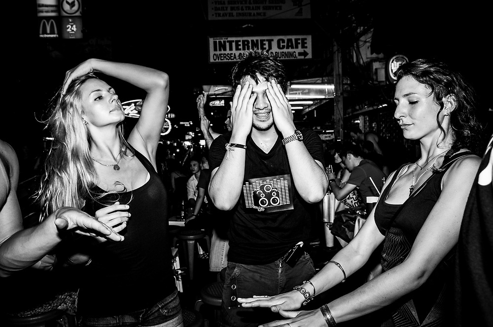 Travelers, pictured shortly after midnight, enjoy the vibe on Khao San Road in Bangkok, Thailand (November 20, 2011)