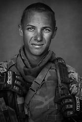 Cpl. Nicholas Reimann, 21, Hutchinson, Kansas, Kilo Co., 3rd Battalion 1st Marines, United States Marine Corps, at the company's firm base in Haditha, Iraq on Sunday Oct. 22, 2005.