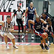 Besiktas's Brad NEWLEY (L) and Efes Pilsen's Charles SMITH (C) Bootsy THORNTON (R), Ermal KURTOGLU (B) during their Turkish Basketball league Play Off semi final second leg match Besiktas between Efes Pilsen at the BJK Akatlar Arena in Istanbul Turkey on Wednesday 12 May 2010. Photo by Aykut AKICI/TURKPIX