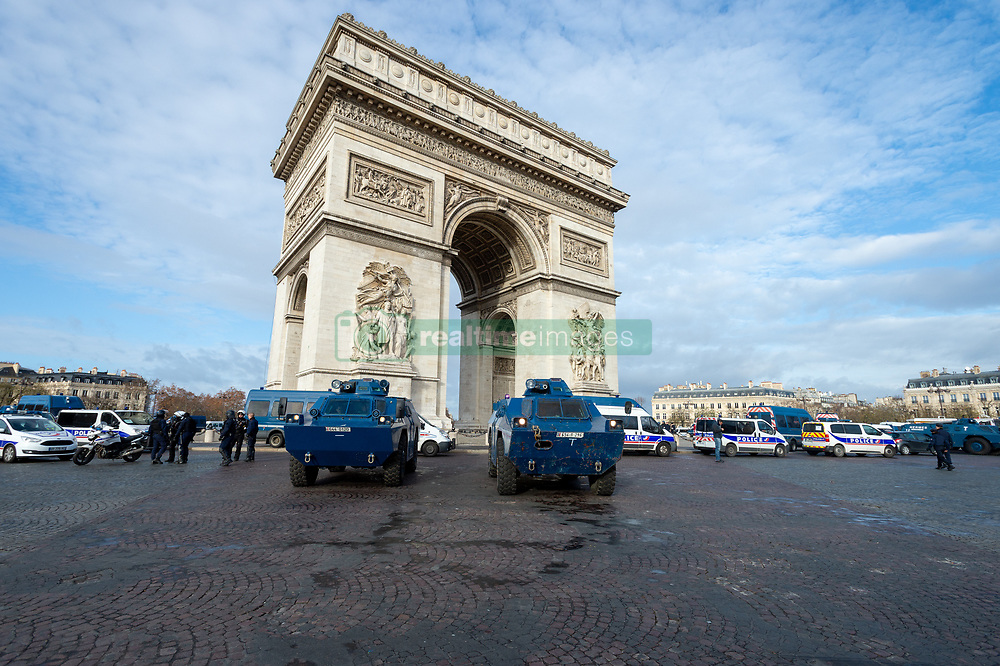 """""""Yellow Vests"""" protesters confront police near the Arch of Triumph in Paris, France, on December 8, 2018. Riot police fired tear gas and water cannon at """"Yellow Vests"""" protesters marching in Paris, France, on Saturday in the fourth week-end action despite President Emmanuel Macron's series of concessions. Photo by Serge Tenani/Avenir Pictures/ABACAPRESS.COM"""