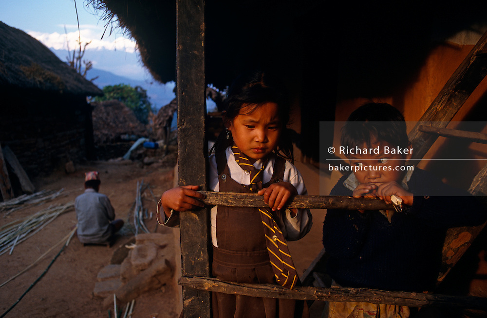 Young Nepali children stand on the terrace of a small hut in the village of Rip in the Gorkha district of central Nepal.