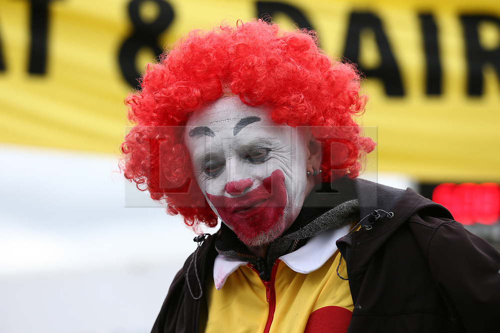 © Licensed to London News Pictures. 22/05/2021. Oldham, UK. An Animal Rebellion activist at the Heywood Distribution Park in Oldham, which supplies hundreds of McDonald's restaurants in the region. The animal rights group are demanding that McDonald's commit to a fully plant-based operation by 2025. Photo credit: Adam Vaughan/LNP
