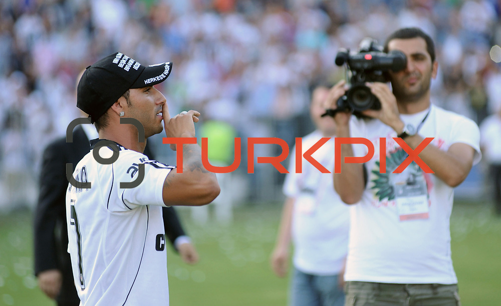 Besiktas Istanbul's new Portuguese soccer player Ricardo Quaresma poses for the media after signing a contract with Turkish soccer club Besiktas at Inonu stadium in Istanbul June 19, 2010.Photo by TURKPIX