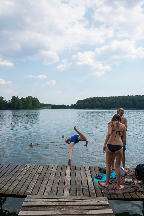 Trakai, Lithuania - August 8, 2015: Young people enjoy a summer afternoon at Lake Luka in Trakai, Lithuania. The town, best known for its picturesque red-brick castle, is located 28 kilometers from Vilnius.