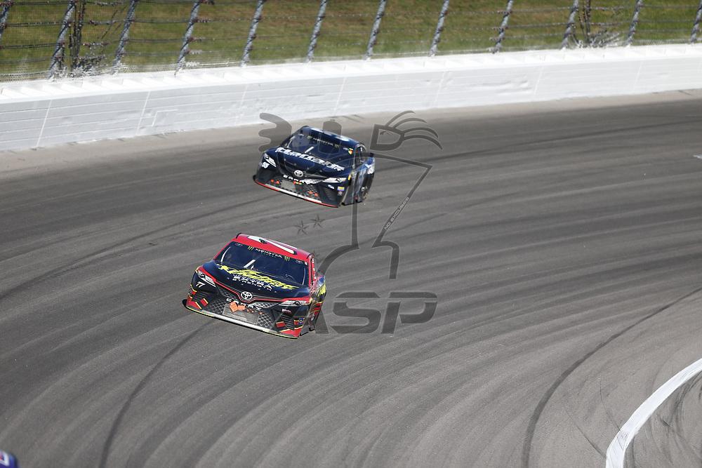 October 22, 2017 - Kansas City, Kansas, USA: \{persons}\ battles for position during the Hollywood Casino 400 at Kansas Speedway in Kansas City, Kansas.