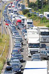 © Licensed to London News Pictures. 23/07/2016<br /> <br /> M20 traffic near the Euro Tunnel Service Station at the back of a very very long queue into Dover, kent.<br /> Dover bound traffic ON THE  M20 in Kent at Junction 11A AND 12.  Queueing traffic because of very long delays at French border contol. <br /> <br /> <br /> (Byline:Grant Falvey/LNP)