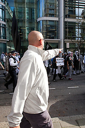 © Licensed to London News Pictures. 11/09/2011. London, UK. EDL supporters confront Muslims Against Crusaders protesters as they are lead to Regents Park Mosque following their demonstration. Radical Islamist group, Muslims Against Crusades, hold a protest outside the US Embassy in Grosvenor Square, London, on the 10th anniversary of the September 11th terrorist attacks on America. A counter-protest was held at the same time by the English Defence League. Photo credit : Joel Goodman/LNP