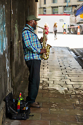 Pictured: A lone saxophonist makes use of the echo effect under a tunnel - before the rush of solo artists hit Edinburgh dring the Feestival<br /> <br /> Ger Harley | EEm 29 June 2019