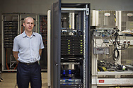 Word: ADVICE<br /> <br /> Caption: Informatician Ian Wood pictured with a Linux cluster used for modelling ingredient effects and optimising formulation design.<br /> <br /> The image is taken from a project entitled 'The Proof Principle' by photographer Colin McPherson, which was commissioned in 2011 by Unilever to celebrate 100 years of work at the company's research and development facility at Port Sunlight, Wirral.<br /> <br /> All images © Colin McPherson, all rights reserved.
