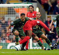Fotball<br /> England 2004/2005<br /> Foto: SBI/Digitalsport<br /> NORWAY ONLY<br /> <br /> Liverpool v Norwich City, Barclays Premiership, 25/09/2004.<br /> Norwich's Youssef Safri (L) shrugs off Liverpool's Djibril Cisse
