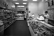 12/11/1965<br /> 11/12/1965<br /> 12 November 1965<br /> Dunn's fish shop on Baggot Street, Dublin. Image shows interior view of the new premises. Note hares hanging on left  and general meats counter at back as well as fish display on right.