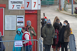 © Licensed to London News Pictures 03/01/2021.        Charlton, UK. People queuing at the football club. A Coronavirus testing centre has been set up by Greenwich Council at Charlton Athletic's football stadium in South East London to rapid test secondary school students and staff. <br /> The rapid test should give results in 30 minutes. Photo credit:Grant Falvey/LNP