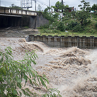 Río Blanco in San Pedro Sula rose and swelled with fast-running water as hurricane Iota pushed into Honduras. Precarious housing on the riverside began to be washed away and people rushed to save their belongings.
