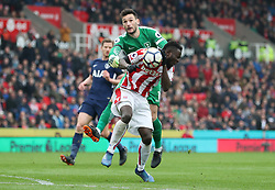 Stoke City's Mame Diouf clashes with and Tottenham Hotspur's Hugo Lloris as he scores Stoke's first goal