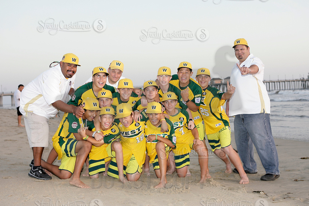 26 September 2011: 2011 Little League Baseball World Series Championship team portrait northside of the Huntington Beach Pier at sunset in Southern California.  Ocean View team WEST beat Hamamtsu City, Japan, 2-1, to become the seventh team from California to win the title on August 28, 2011 in South Williamsport, PA. In Photo: Furry, Takada, Windisch, Cianca, Kotkosky, Mayorga, Palmer, Anderson, Catano, Danner, Pratto, Martinez.  Coaches: Tony Cianca, Jose Martinez and Jeff Pratto.