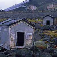 Hooker Island, Franz Josef Land,  Russia. Weathered dog houses at abondoned science station at Tikhaya Bay.