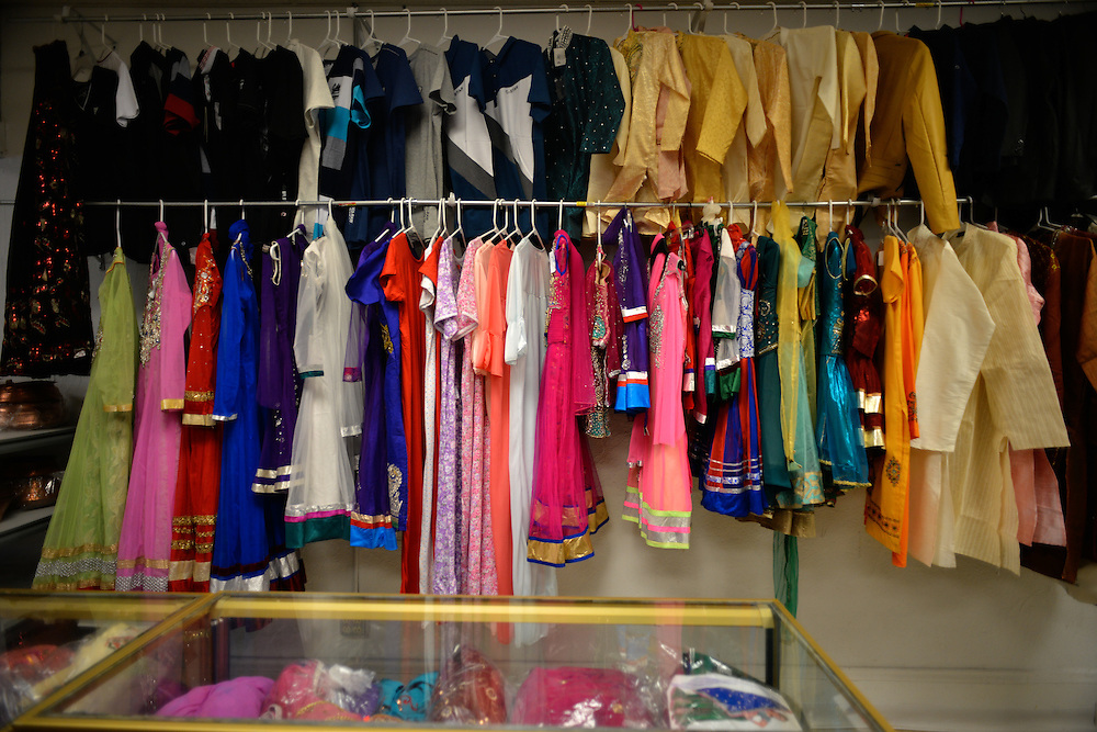 Clothing items for sale at Dhimal's Mini Marts grocery store.