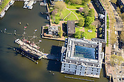Nederland, Noord-Holland, Amsterdam, 09-04-2014;<br /> Detail Scheepvaartmuseum met replica VOC-schip Amsterdam, ernaast het marineterrein. <br /> Close up navy area (right) and the National Maritime Museum (white building).<br /> luchtfoto (toeslag op standard tarieven);<br /> aerial photo (additional fee required);<br /> copyright foto/photo Siebe Swart
