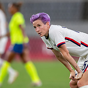 TOKYO, JAPAN - JULY 21:  Megan Rapinoe #15 of the United States reacts during her sides 3-0 loss during the USA V Sweden group G match at Tokyo Stadium during the Tokyo 2020 Olympic Games on July 21, 2021 in Tokyo, Japan. (Photo by Tim Clayton/Corbis via Getty Images)