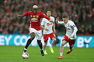 Paul Pogba of Manchester Utd (l) runs with the ball past Steven Davis of Southampton ®.  EFL Cup Final 2017, Manchester Utd v Southampton at Wembley Stadium in London on Sunday 26th February 2017. pic by Andrew Orchard, Andrew Orchard sports photography.