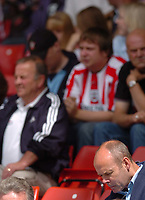 Fotball<br /> England 2005/2006<br /> Foto: SBI/Digitalsport<br /> NORWAY ONLY<br /> <br /> Southampton v Anderlecht<br /> Pre Season Friendly, 30/07/2005. <br /> <br /> Sir Clive Woodward sits with empty seat around him.