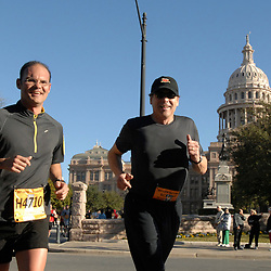 Austin, TX February 18, 2007:  Texas Governor Rick Perry (r) heads past the State Capitol with security guard Chris Brannen (l)toward the finish line of the half-marathon Sunday at the Austin Marathon 26.2 mile race. The race is the 15th-biggest U.S. marathon.  ©Bob Daemmrich /