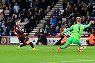 Goal - Ryan Fraser (24) of AFC Bournemouth puts the ball through the legs of Jonas Lossl (1) of Huddersfield Town to score a goal to give a 2-0 lead to the home team during the Premier League match between Bournemouth and Huddersfield Town at the Vitality Stadium, Bournemouth, England on 4 December 2018.