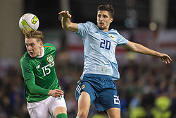 November 15, 2018 - Dublin, Ireland - Craig Cathcart of N.Ireland and Ronan Curtis of Ireland jump for the ball during the International Friendly match between Republic of Ireland and Northern Ireland at Aviva Stadium in Dublin, Ireland on November 15, 2018  (Credit Image: © Andrew Surma/NurPhoto via ZUMA Press)