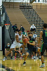 5 February 2021: Boys Basketball game between the UHigh Pioneers and the Normal West Wildcats in Normal West High School, Normal IL