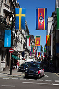 Flags from all nations in the World hang across streets in the West End of London, UK. Here on Jermyn Street in celebration of the 2012 Olympic Games, this part of central London is filled with colour.