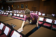 09 JANUARY 2012 - PHOENIX, AZ:    Frances Garcia cleans the desks of state representatives in the House of Representatives before the legislature convened at the Arizona State Capitol in Phoenix Monday. The Arizona legislature started its 2012 session and Gov. Jan Brewer delivered her State of the State Monday, Jan 9.                 PHOTO BY JACK KURTZ