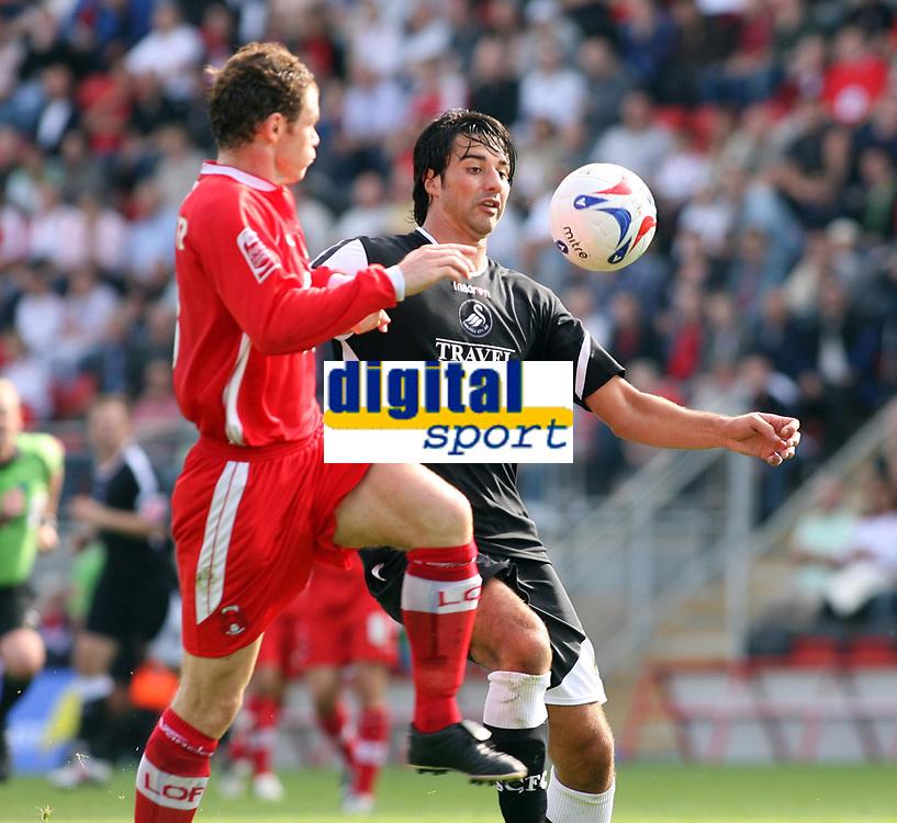 Photo: Chris Ratcliffe.<br />Leyton Orient v Swansea City. Coca Cola League 1. 26/08/2006.<br />Matt Lockwood (L) of Leyton Orient clashes with Rory Fallon of Swansea.