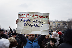 © Licensed to London News Pictures. 05/03/2014. Ukraine. Demonstration in Donetsk, Ukraine, involving groups of pro-Russia and anti-Putin protestors, in the wake of events in Kyiv. Photo credit : Christopher Nunn/LNP