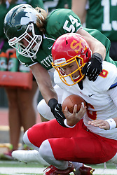 19 September 2015:  Sammy Sasso sacked by Sean Garvey during an NCAA division 3 football game between the Simpson College Storm and the Illinois Wesleyan Titans in Tucci Stadium on Wilder Field, Bloomington IL