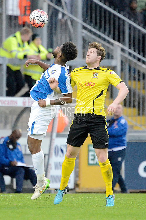 Chesham United defender George Fenton beats Bristol Rovers striker Ellis Harrison to a header during the The FA Cup match between Bristol Rovers and Chesham FC at the Memorial Stadium, Bristol, England on 8 November 2015. Photo by Alan Franklin.
