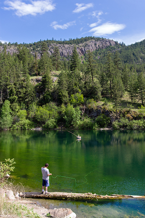Two people fly fishing in Yellow Lake near Penticton, British Columbia, Canada