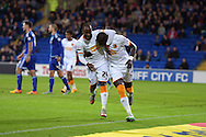 Mohamed Diame of Hull city ® celebrates with teammate Sone Aluko after he scores his teams 1st goal. Skybet football league championship match, Cardiff city v Hull city at the Cardiff city stadium in Cardiff, South Wales on Tuesday 15th Sept 2015.<br /> pic by Andrew Orchard, Andrew Orchard sports photography.