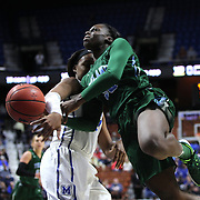 Tierra Jones, Tulane, is rejected by Asianna Fuqua-Bey, Memphis, during the Tulane Green Wave Vs Memphis Tigers Quarter Final match at the  2016 American Athletic Conference Championships. Mohegan Sun Arena, Uncasville, Connecticut, USA. 5th March 2016. Photo Tim Clayton