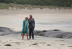 The Prince of Wales and Duchess of Cornwall walk on Derrynane beach in Co Kerry during the royal tour of the Republic of Ireland.