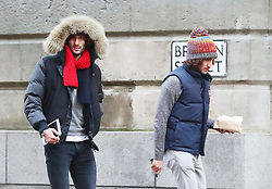 Manchester United's Marouane Fellaini and his twin brother are spotted in Manchester city centre on Friday afternoon at about 3.30pm