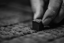 October 14, 2016 - Qingdao, Qingdao, China - Binzhou,CHINA-October 13 2016: (EDITORIAL USE ONLY.CHINA OUT) Ruan Tongmin works in his studio of movable type printing in Qingdao, east China's Shandong Province, October 14th, 2016. Ruan Tongmin, born in a family of printing, is fond of studying on the industry of printing. He has collected hundreds of various printing machines and established a studio specializing on movable type printing, aiming to revitalize Chinese traditional culture of movable type printing. Movable type is the system and technology of printing and typography that uses movable components to reproduce the elements of a document (usually individual letters or punctuation) usually on the medium of paper which was first invented in ancient China. (Credit Image: © SIPA Asia via ZUMA Wire)