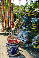 Stone Tiger at Hung Long Tu Pagoda, Phu Quoc - Hung Long Tu Pagoda was built by a well known monk named Nguyen Kim Muon. This pagoda is located in a peaceful setting on a rocky outcrop.  The Pagoda is also known as the Su Muon pagoda.