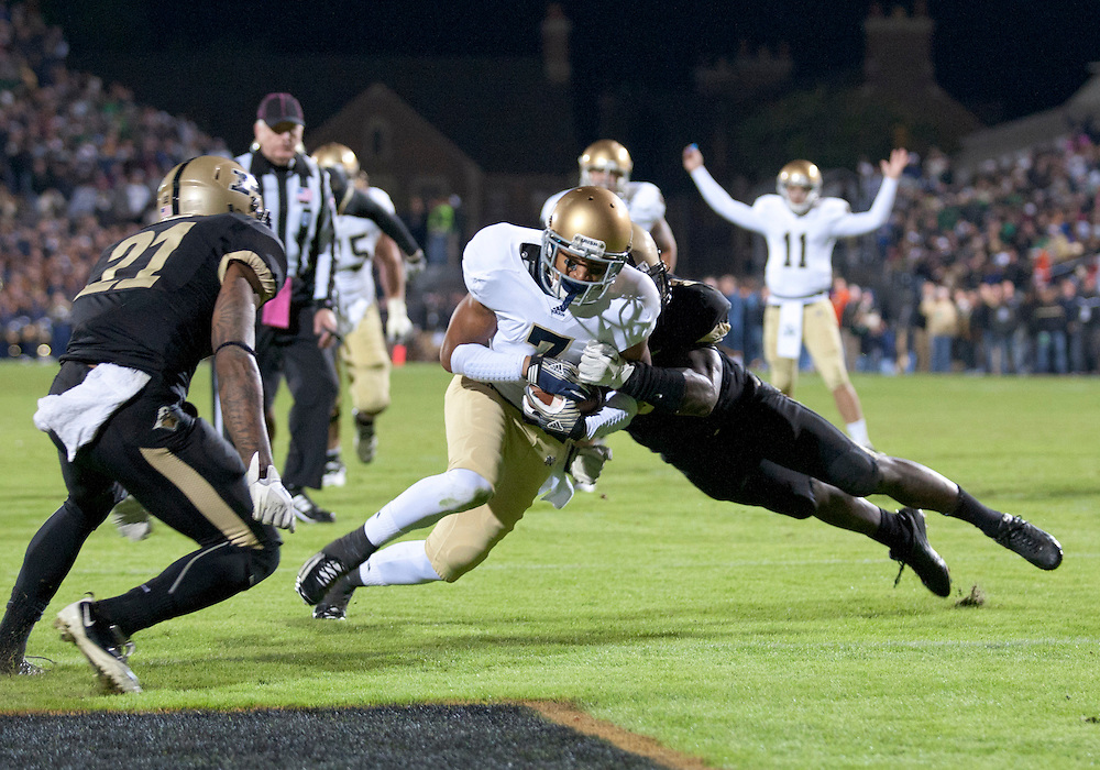October 01, 2011:  Notre Dame wide receiver TJ Jones (#7) splits he Purdue defenders to score touchdown during NCAA Football game action between the Notre Dame Fighting Irish and the Purdue Boilermakers at Ross-Ade Stadium in West Lafayette, Indiana.  Notre Dame defeated Purdue 38-10.