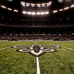August 27, 2010; New Orleans, LA, USA; A general view of the New Orleans Saints fleur de lis logo at the 50-yardline following a preseason game at the Louisiana Superdome. The New Orleans Saints defeated the San Diego Chargers 36-21. Mandatory Credit: Derick E. Hingle