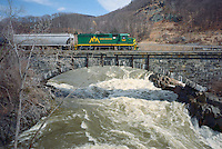 Green Mountain train crosses the Fitchburg Railroad stone arch bridge, built in 1899, at Bellows Falls, VT.