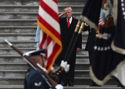 January 20, 2017 - Washington, District of Columbia, U.S. - US President DONALD TRUMP, 70, salutes a military honor guard during his presidential inauguration at the United States Capitol Building, in Washington. (Credit Image: © Gary Hershorn via ZUMA Wire)