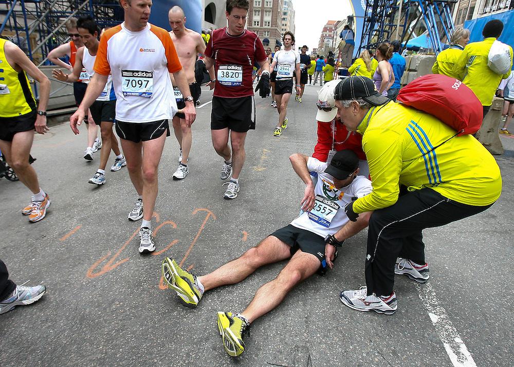 (041910  Boston, MA)  Donald Sullivan, of MN, collapses after crossing the finish line of the 2010 Boston Marathon.